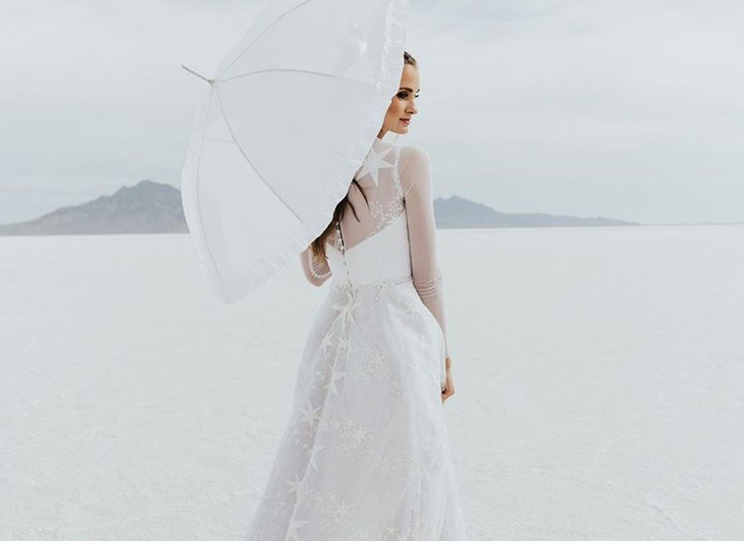 Model wearing a white wedding dress